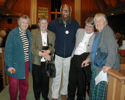 Sister Helen Prejean, second from right, with members of audience.